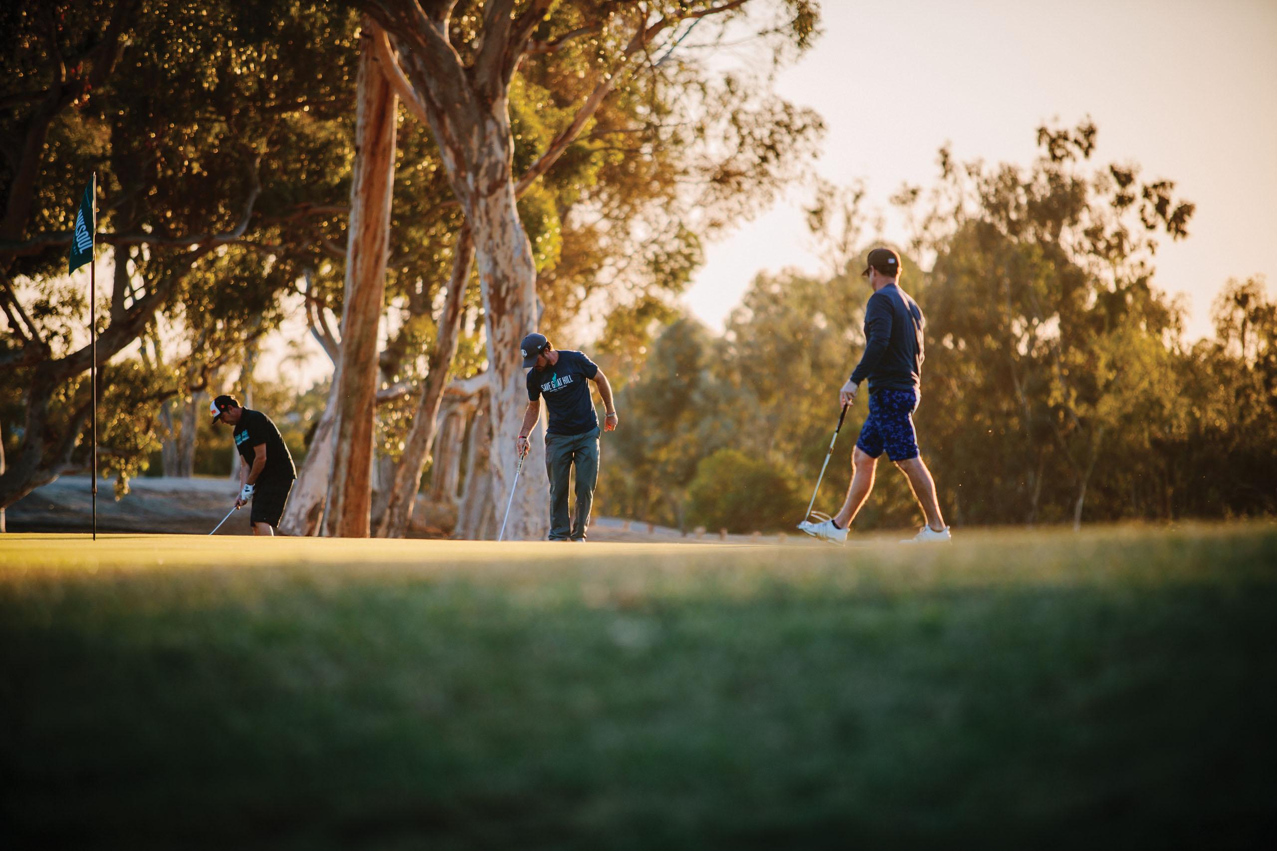 Golfer's at sunset