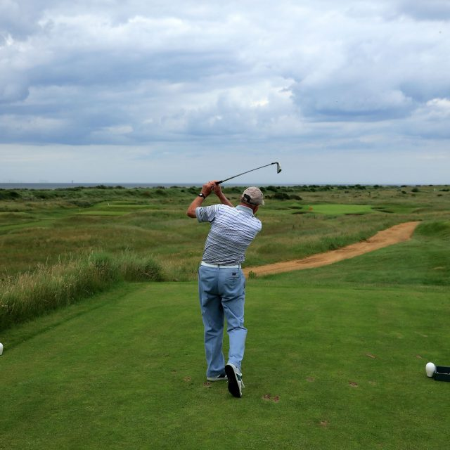 Robert Taylor of England plays a tee shot at the 189 yards par 3, 16th hole at Hunstanton Golf Club where he achieved a unique feat in golf when he holed in one on three consecutive days on May 31st, June 1st and June 2nd 1974 whilst playing for Leicestershire in the Eastern Counties Foursomes on June 28, 2016 in Hunstanton, Norfolk, England. Photo by David Cannon/Getty Images