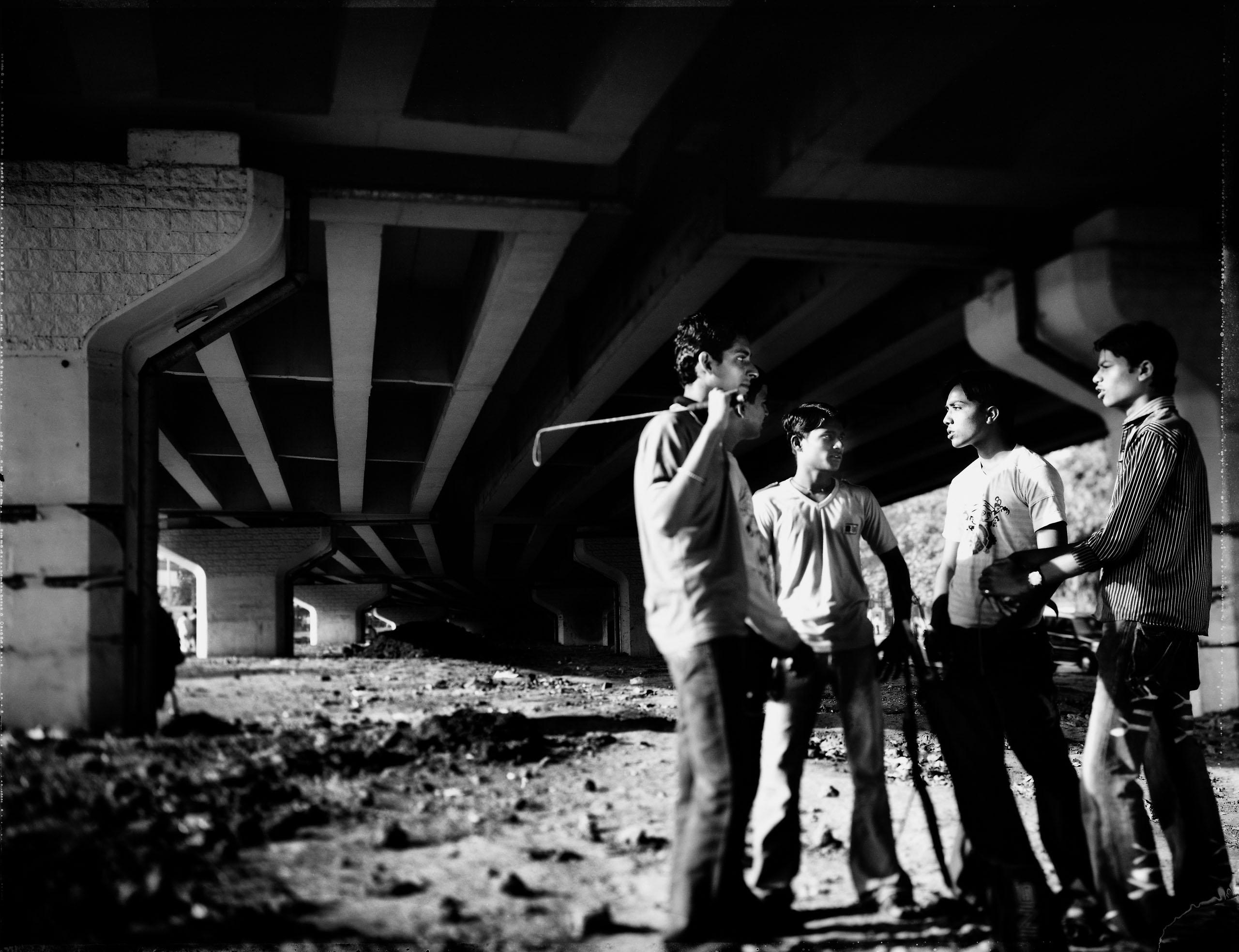 (From left) Harish, Laxman, Sanjay and Raja discuss course management. Photo by Tomasz Gudzowaty.