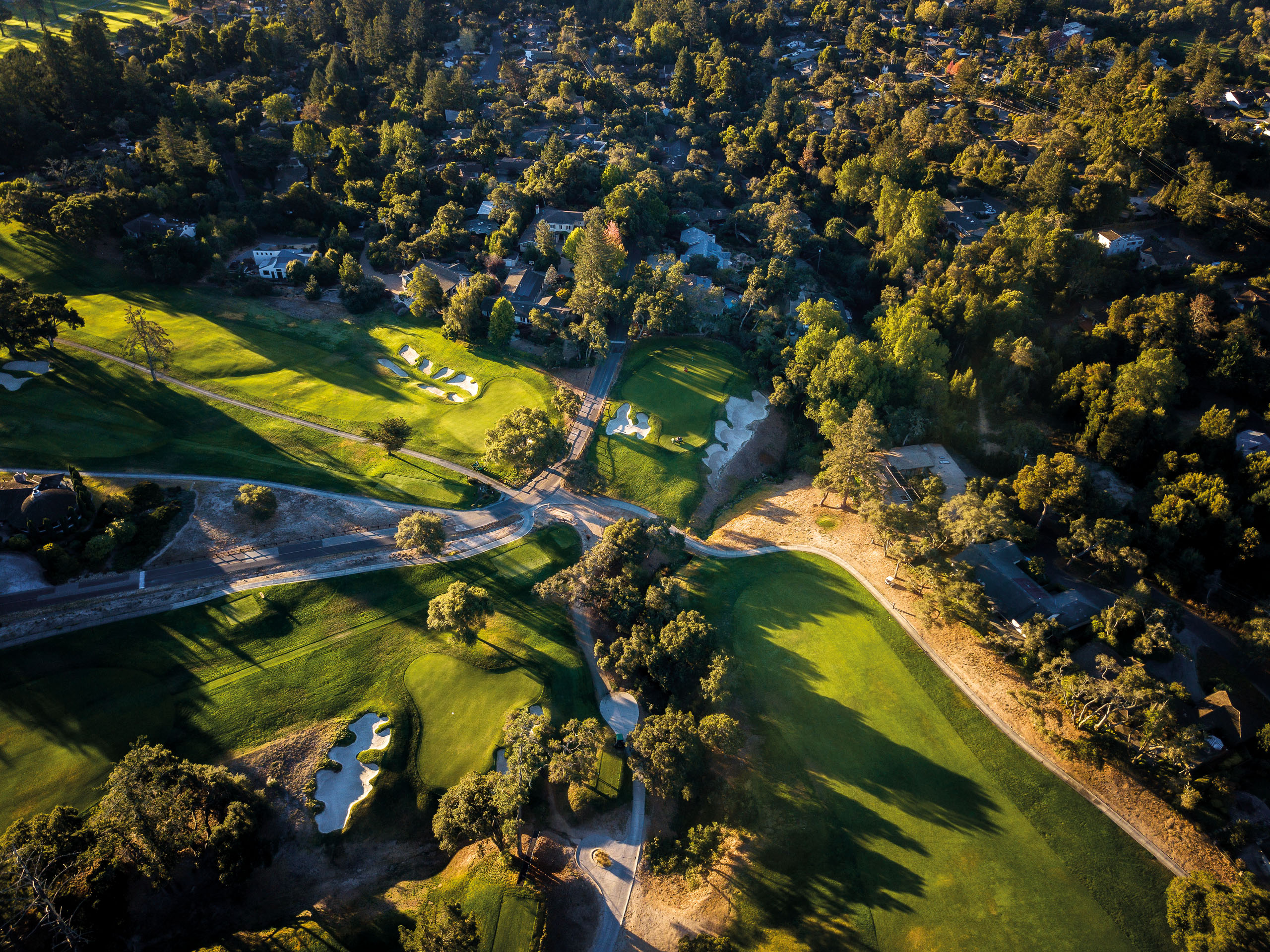 The base of the Santa Cruz Mountains provided Alister MacKenzie with an incredible canvas, and he produced a masterpiece that feels innovative nearly 100 years after it was built. With its diabolical bunker on the right of the green, the par-4 16th remains an all-time MacKenzie classic. Image by Mike Gibbons