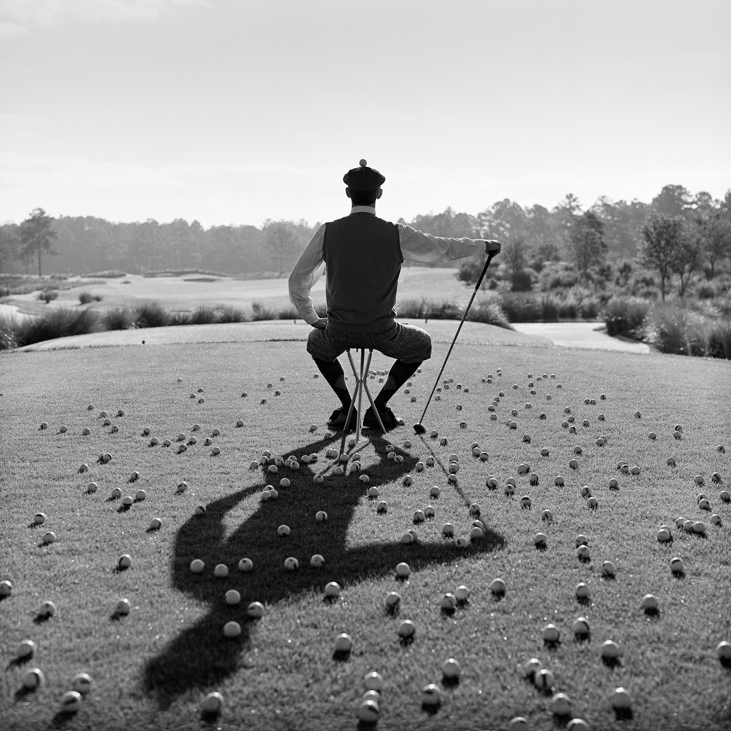 Seated with golf balls, St. Augustine, 1998