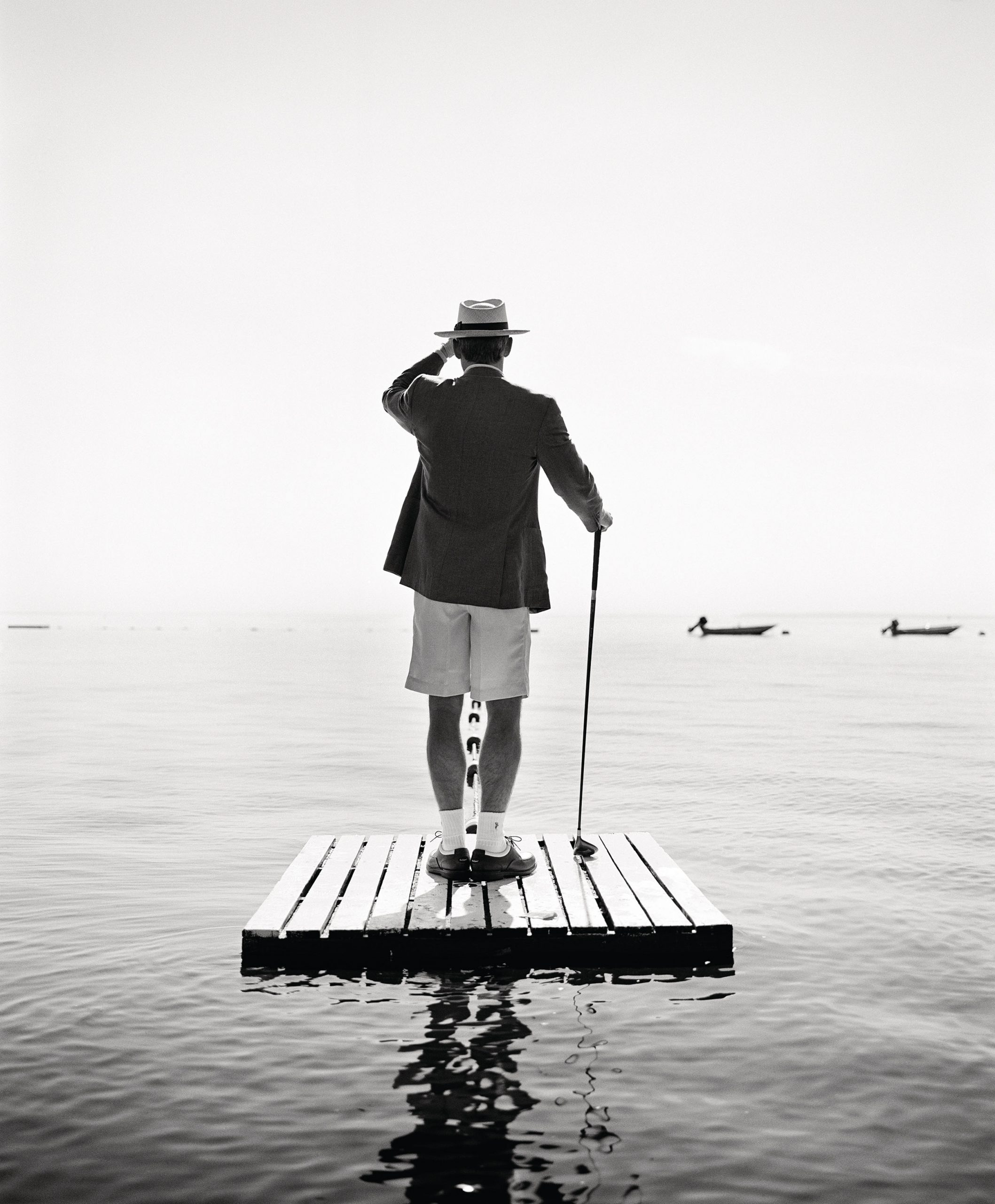 Dodge on dock with golf club, Harrison, New York, 1998