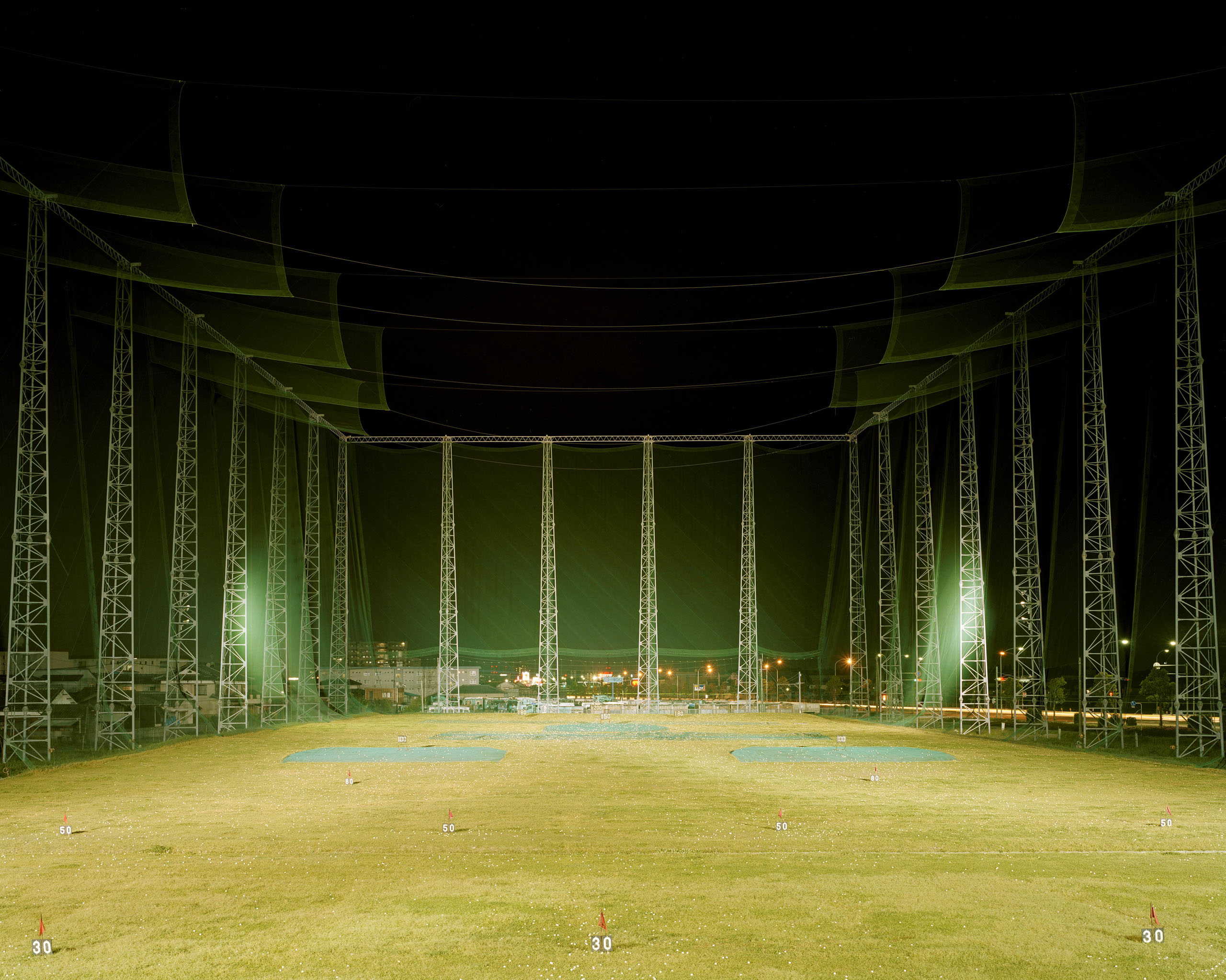 Golfing Into The Night At This Miyazaki, Japan, Driving Range In 2000. Photo by Mark Power.