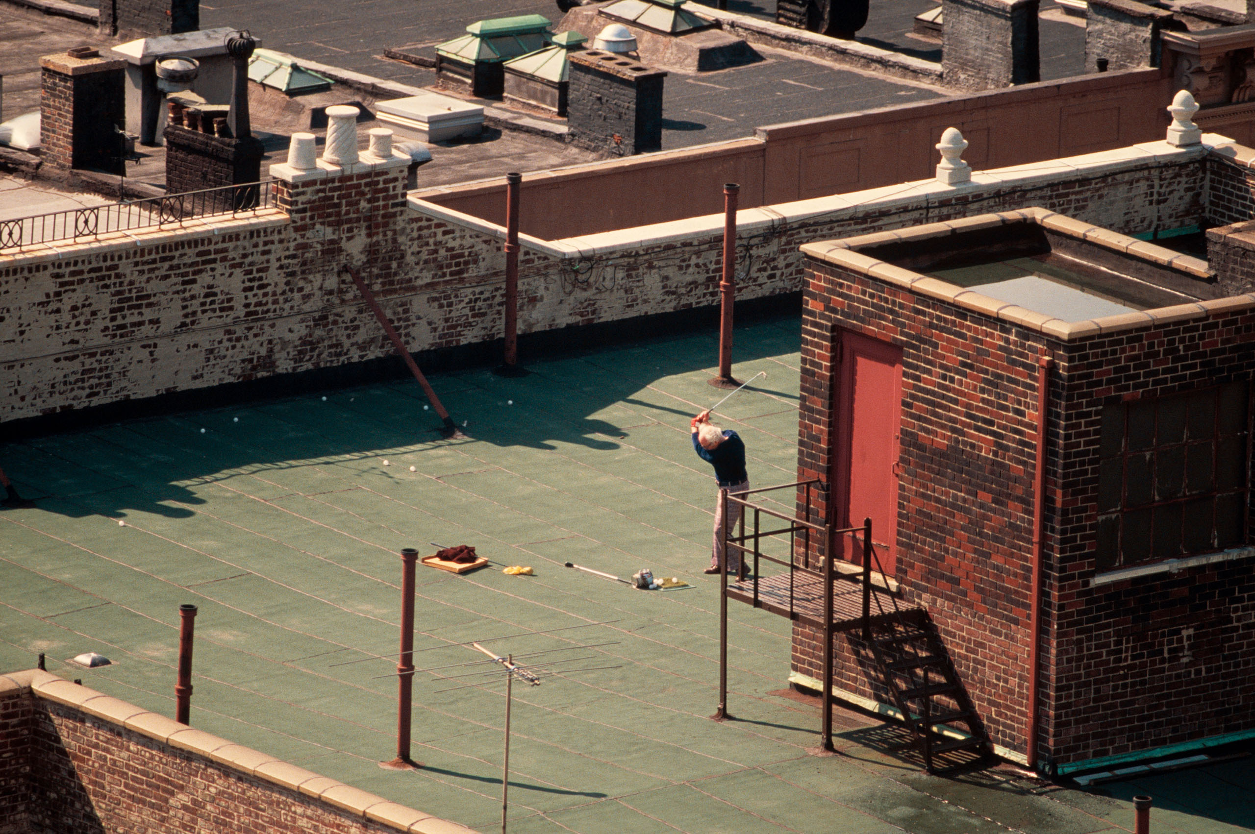 Getting The Best Out Of A Midtown Manhattan Rooftop During A Sunny Day In 1983. Photo by Thomas Hoepker.