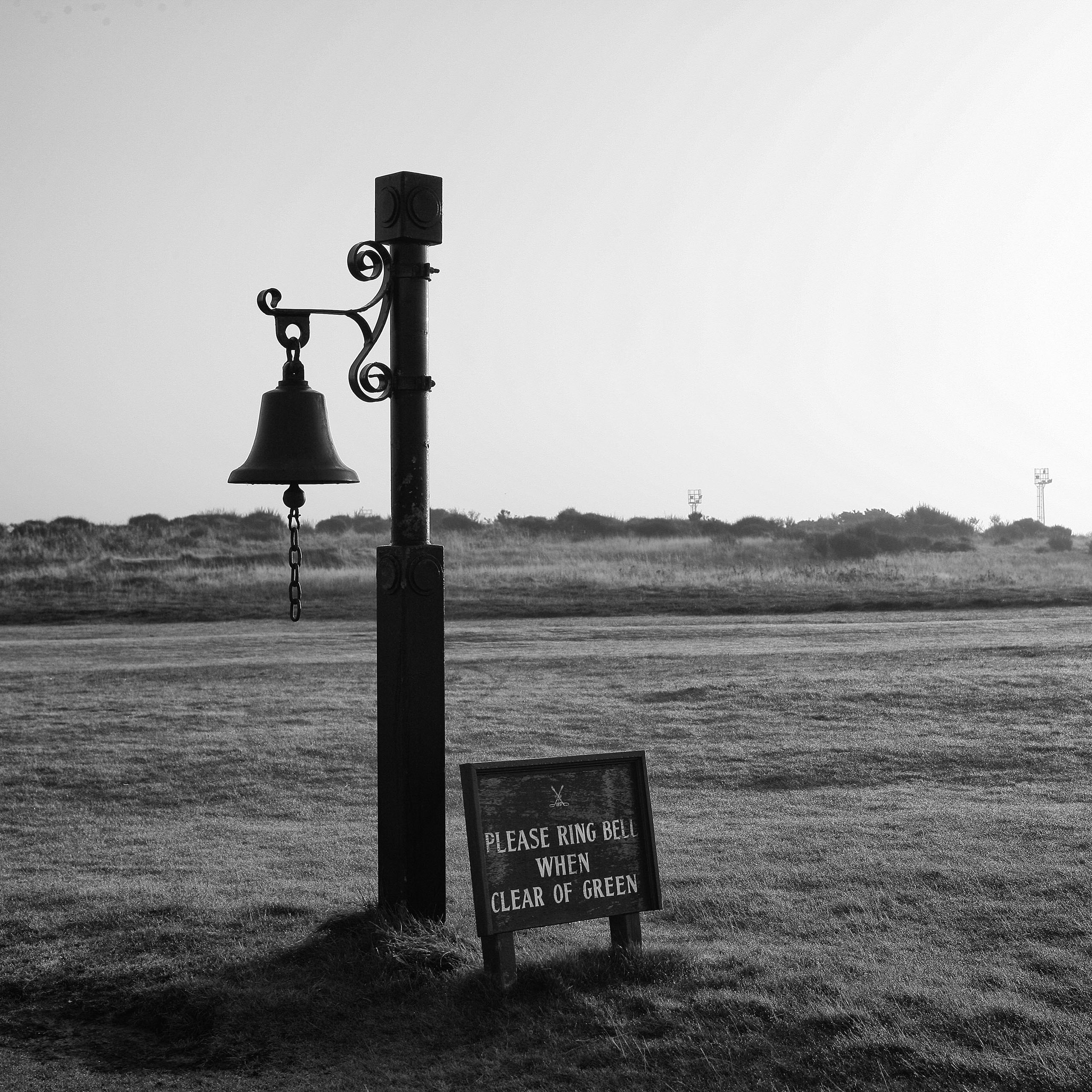The bell on the long par-3 fifth hole at Prestwick Golf Club. It's a blind shot, so when you finish putting, you sound the bell, notifying the next group on the tee. Photo by Taku Miyamoto