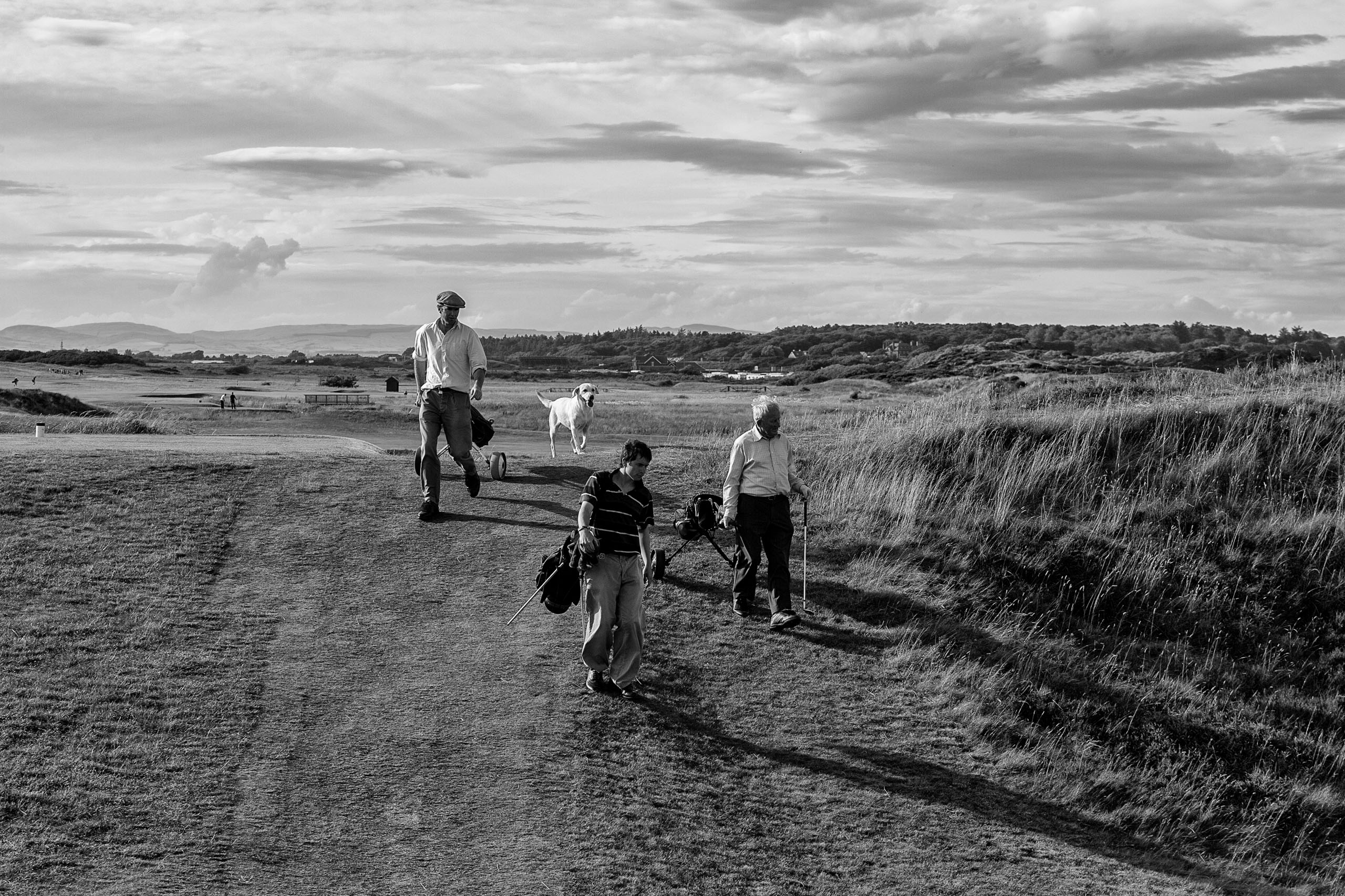 A family playing golf with their dog in tow at Prestwick Golf Club. I felt complete happiness watching them. Maybe this is what golf is all about. Photo by Taku Miyamoto