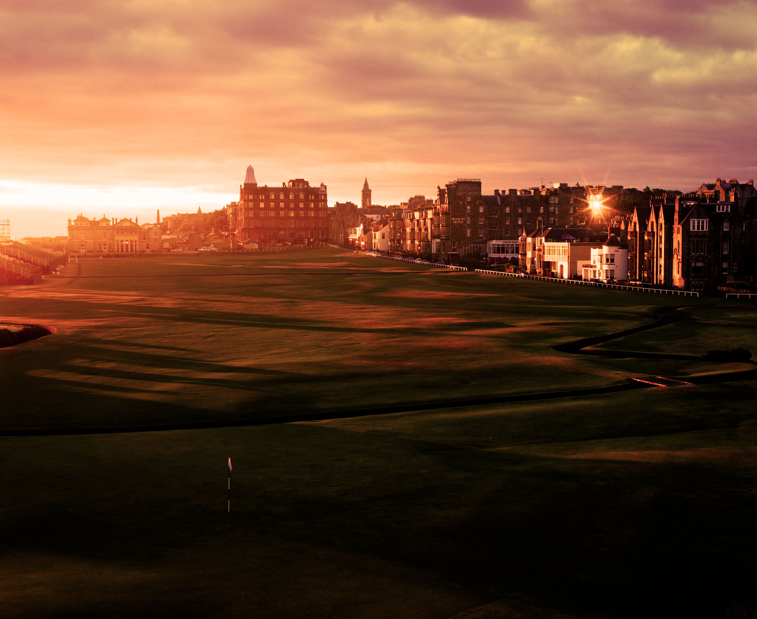 After I finished covering the Open Championship, I spent a week at St. Andrews. One day I climbed up the TV tower with my camera and positioned myself. It was too cloudy and I was about to give up the shot when the clouds parted and the light started shining through. I don't know how many times I have been to St. Andrews over the years, and the weather can be bad most days. But sometimes there's a thing called luck. Photo by Taku Miyamoto