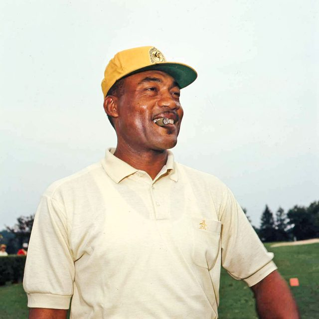 """The years of indignities that Charlie Sifford suffered on and off the course forced him to develop thick skin and an instinct to fight for what he thought was his. """"The things he went through did not go down well with him,"""" Sifford's friend and fellow pro Larry Mowry told Golf Digest. """"Let's be honest: Charlie could be difficult."""" So when he did smile, as in this photo the week after his first PGA Tour victory at the Greater Hartford Open, it was a genuine event. Photo: Old Golf Images/SBM"""