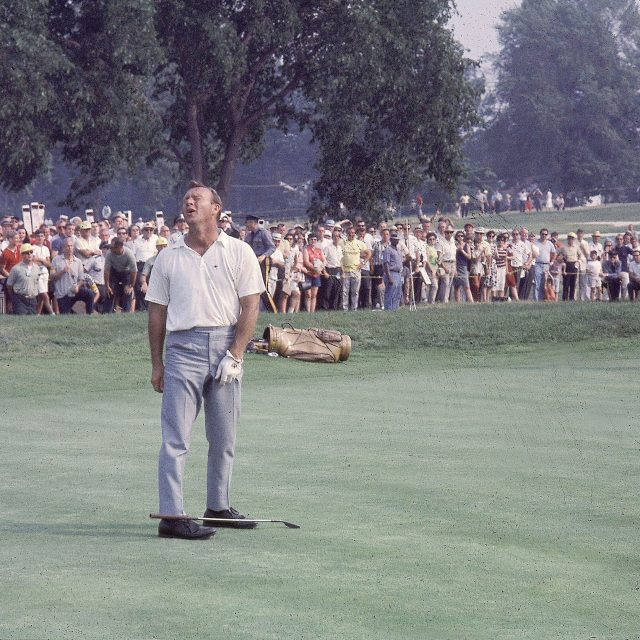 Arnold Palmer upset on green after missing birdie. Photo by Marvin E. Newman/Sports Illustrated/Getty Images