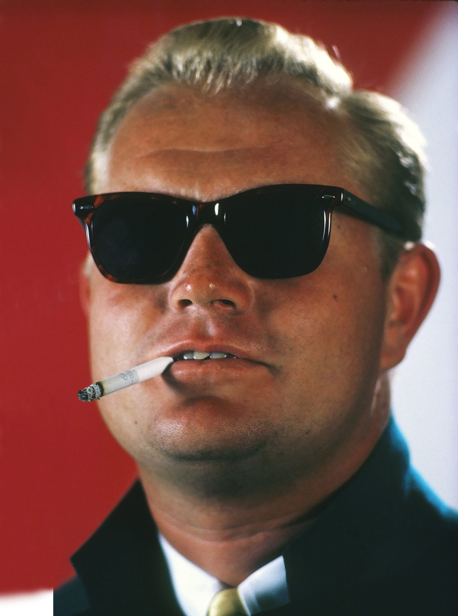 Closeup portrait of Jack Nicklaus wearing Masters green blazer and sunglasses with cigarette in mouth. West Palm Beach, FL. Photo by Walter Iooss Jr. /Sports Illustrated/Getty Images