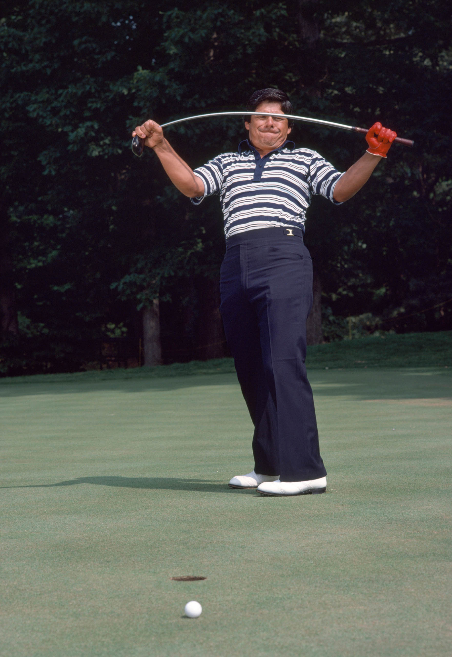 American golfer Lee Trevino shows his displeasure after missing his putt with a wood, circa 1980. (Photo by Leonard Kamsler/Popperfoto via Getty Images)