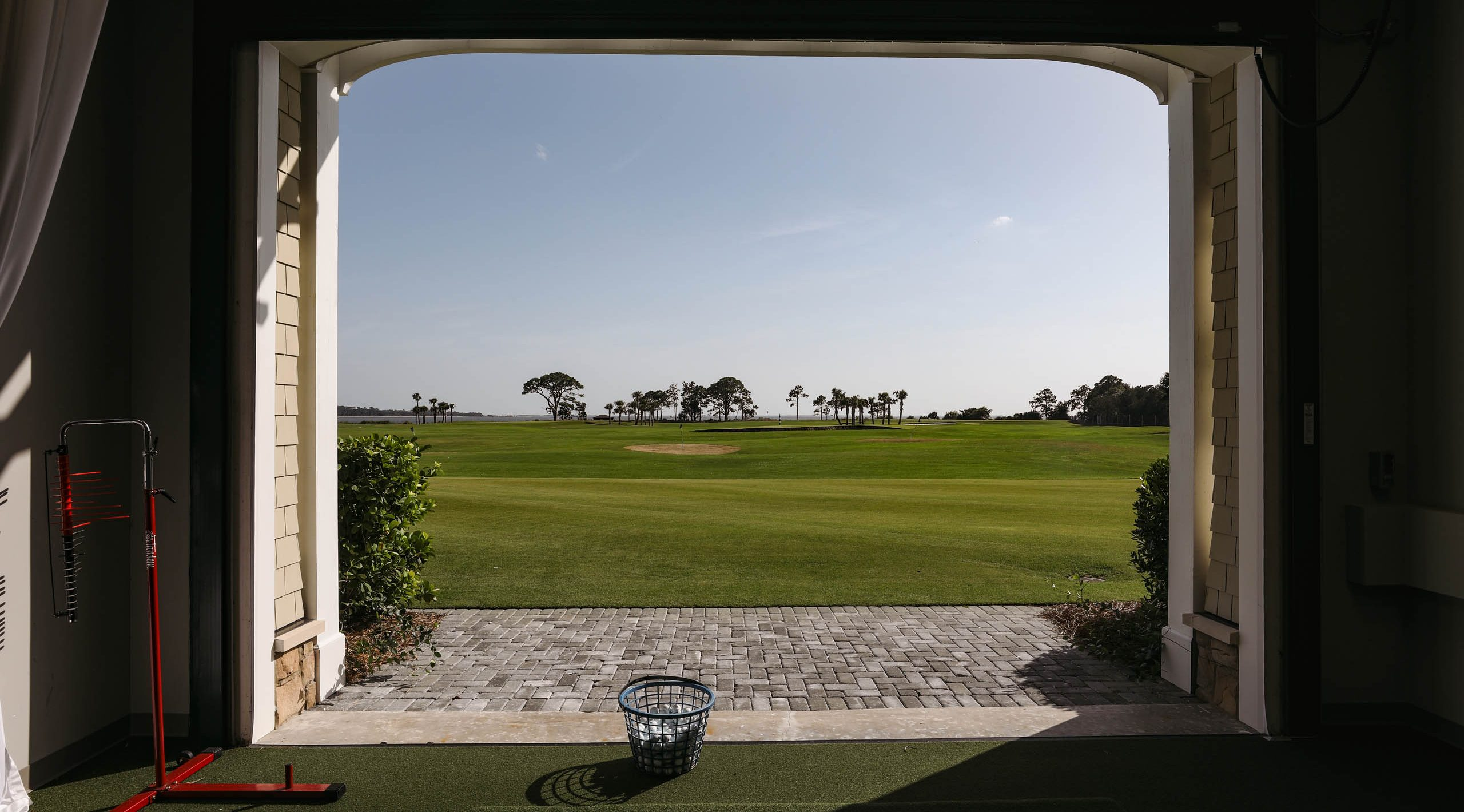 The hitting bays, and driving range at the new Golf Performance Center at Sea Island.